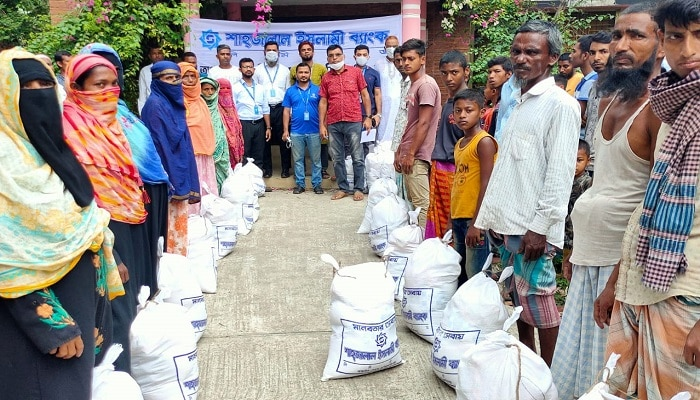 Distribution of relief materials by Shahjalal Islami Bank Limited in Dhaka, Noakhali